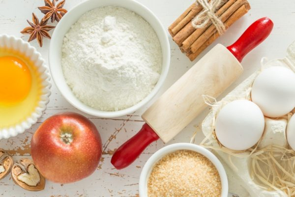 Baking ingredients on rustic background, top view, long format banner
